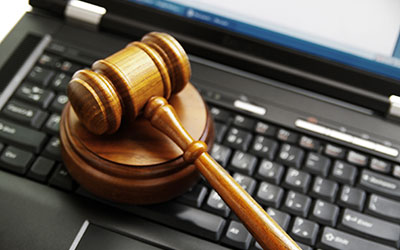gavel on a computer